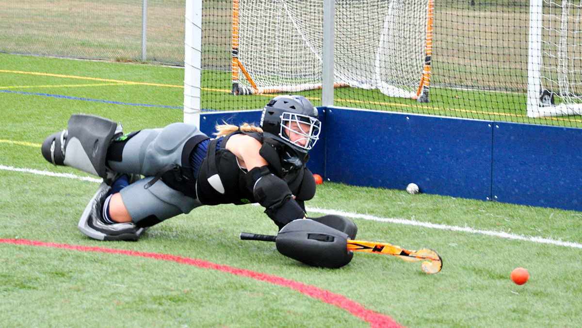Members of the field hockey team tried out for goalie position