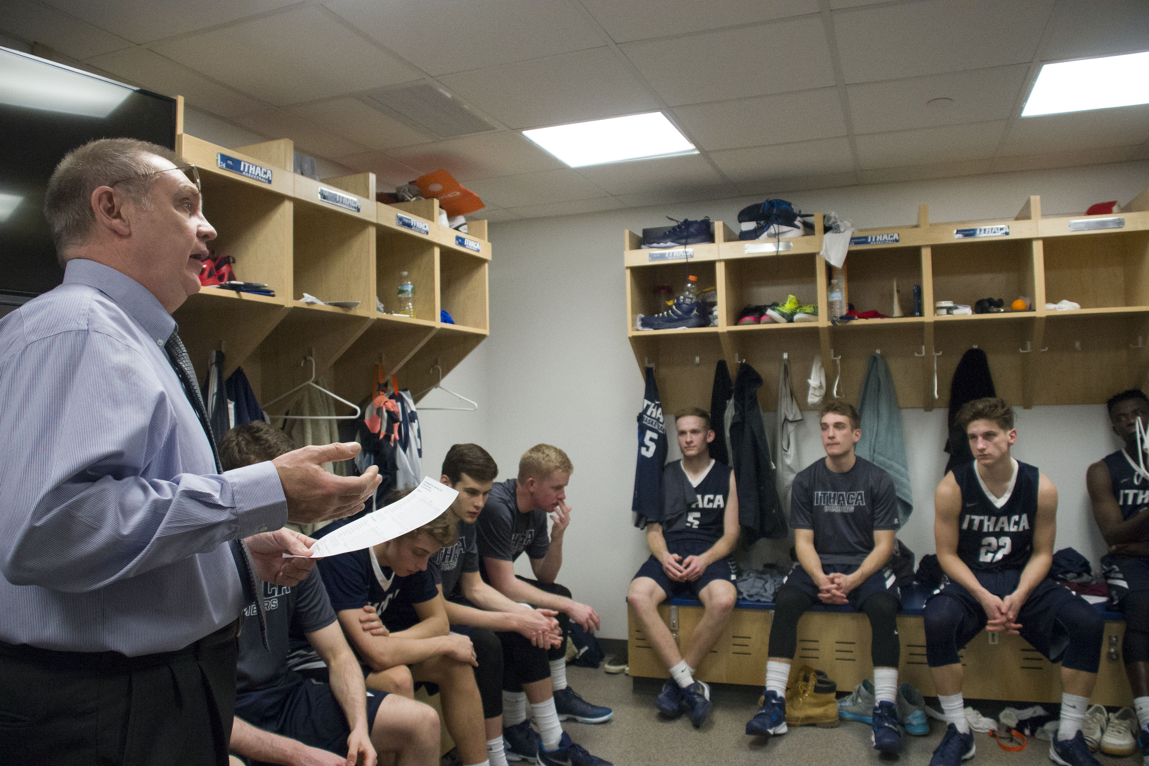Mullins addresses the team in the locker room before the game.