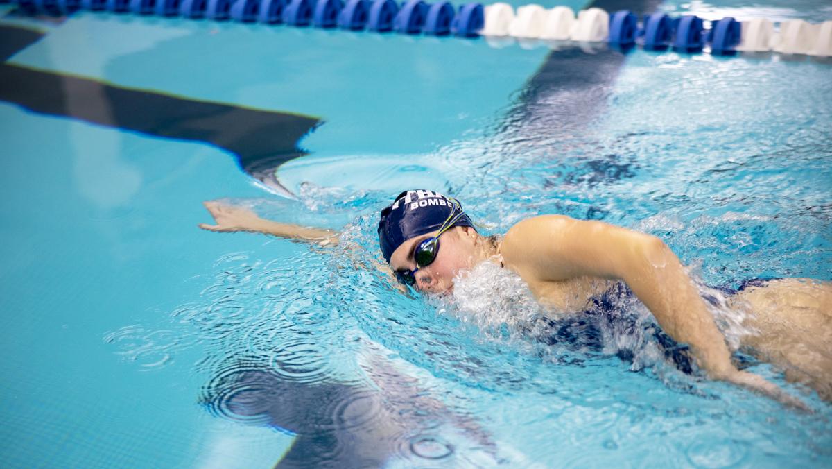 Freshman swimmer splashes through chronic injuries
